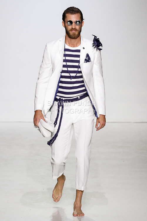 Model walks runway in an outfit from the Nick Graham Spring Summer 2018 Atlantis collection, at Skylight Clarkson Square on July 11, 2017; during New York Fashion Week: Men's Spring Summer 2018.