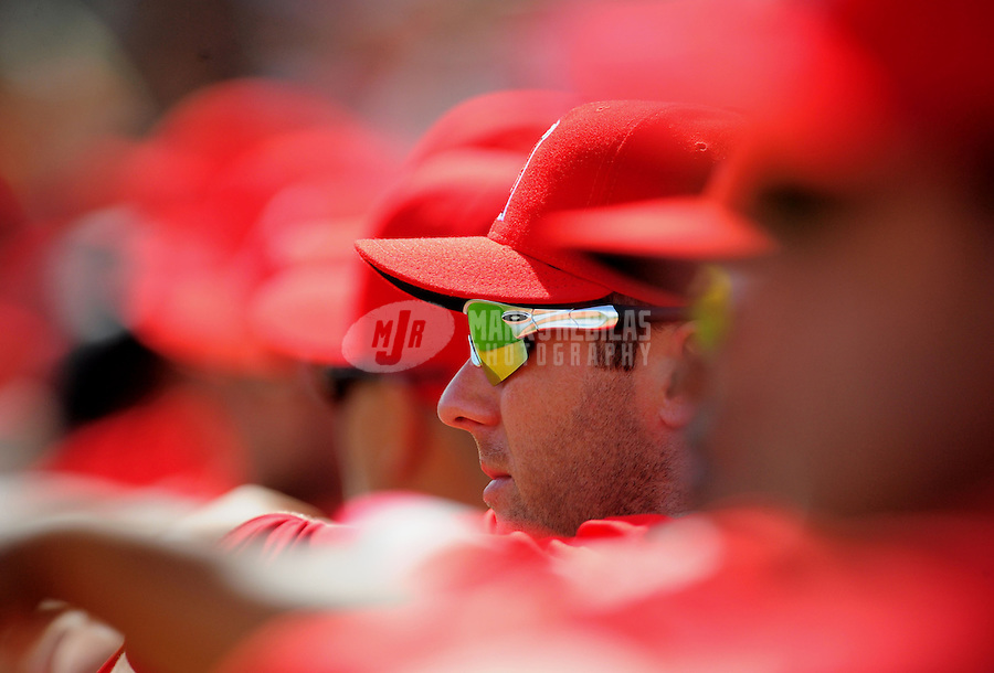 Mar. 4, 2012; Phoenix, AZ, USA; Los Angeles Angels infielder Andrew Romine watches from the bench in the first inning against the Oakland Athletics during a spring training game at Phoenix Municipal Stadium.  Mandatory Credit: Mark J. Rebilas-