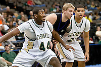January 14, 2010:    Jacksonville forward Glenn Powell (44) tries to block out Lipscomb center Justin Glenn (15) while Jacksonville guard Tevin Galvin (23) looks on during Atlantic Sun conference game action between the Jacksonville Dolphins and the Lipscomb Bisons at Veterans Memorial Arena in Jacksonville, Florida.  Jacksonville defeated Lipscomb 79-73.