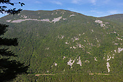 Crawford Notch State Park - Mount Willey in the White Mountains, New Hampshire USA. The old Maine Central Railroad can be seen and is now used by the Conway Scenic Railroad
