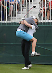 Vernon Kay jumps on his playing partner Ben Shepherd to celebrate.<br /> The Celebrity Cup 2015<br /> Celtic Manor Resort<br /> <br /> 04.07.15<br /> &copy;Steve Pope - SPORTINGWALES