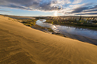 Sunset over the Ahnewetut Creek, the Great Sand Dunes in the Kobuk Valley National Park, Arctic, Alaska.