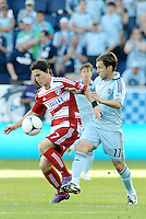 Zach Loyd (17) FC Dallas defender controls the ball in front of Bobby Convey Sporting KC... Sporting KC defeated FC Dallas 2-1 at LIVESTRONG Sporting Park, Kansas City, Kansas.