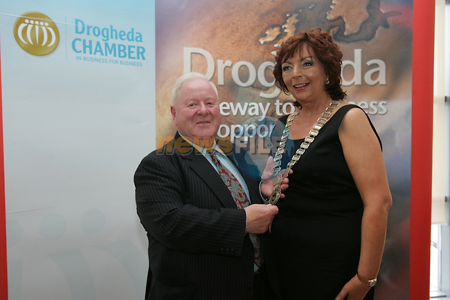 Drogheda and district chamber agm in Bru..Outgoing president Eugene kierans hands over the chains of office to Patricia Rooney the new incoming president...Picture Fran Caffrey/Newsfile.ie