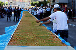 Palestinians making the biggest dish of traditional sweets Knafa into the Guinness Book of Records in the West Bank city of Nablus on July 18 2009. Photo by Issam Rimawi