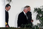 Washington, DC - December 1, 2009 -- (L to R) Chairman of the Joint Chiefs of Staff Admiral Michael Mullen, Defense Secretary Robert Gates and Secretary of State Hillary Rodham Clinton walk from the Oval Office to the Diplomatic Room of the White House in Washington on Tuesday, December 1, 2009. Mullen, Gates and Clinton are traveling with U.S. President Barack Obama to West Point Military Academy in New York where President Obama will speak on a planned increase of troops and exit strategy for the war in Afghanistan. .Credit: Alexis C. Glenn / Pool via CNP