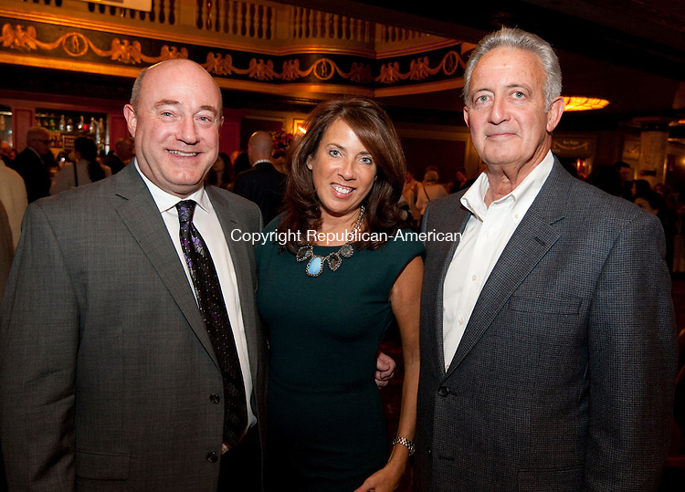 WATERBURY, CT--- -102115JS33---Min Street Waterbury ECO Carl Rosa, Lynnette Letsky-Piombo, a member of the Scholarship Committee  and Pat McKinney, President of the Board of Directors for Main Street Waterbury, at the annual Main Street Waterbury Community Partnership Awards held at the Palace Theater. <br /> Jim Shannon Republican-American