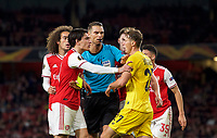 Referee Sandro Schärer between Hector Bellerín of Arsenal & Mergim Vojvoda of Standard Liege during the UEFA Europa League match between Arsenal and Standard Liege at the Emirates Stadium, London, England on 3 October 2019. Photo by Andrew Aleks.