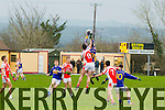 The Bernard O'Callaghan Memorial Senior Football Championship 2014 Quarter Final Brosna V St. Senan's, sponsored by McMunns Ballybunion, Saturday November 29th 2014. Held in Duagh. <br /> <br /> Brosna's Shane Curtin and St. Senan's Jason Brown going high and hard for the ball.