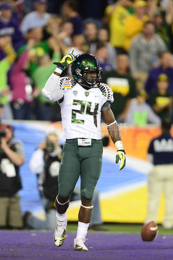 Jan. 3, 2013; Glendale, AZ, USA: Oregon Ducks running back Kenjon Barner (24) celebrates his a touchdown against the Kansas State Wildcats in the second quarter during the 2013 Fiesta Bowl at University of Phoenix Stadium. Mandatory Credit: Mark J. Rebilas-