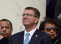 United States Secretary of Defense Ash Carter looks on as US President Barack Obama makes remarks in the Memorial Amphitheater at Arlington National Cemetery in Arlington, Virginia after laying a wreath at the Tomb of the Unknown Soldier on Veteran's Day, Friday, November 11, 2016.<br />
