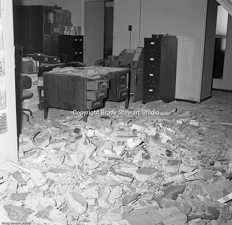 Pittsburgh PA:  View of an office during the demolition of one of downtown Pittsburgh's grand department stores, Rosenbaums. Located at Penn Avenue and Sixth Street in Pittsburgh, the store closed in 1960 and taken down in 1963 to make way for the Sixth Avenue garage.  The demolition work was completed by D&H Building Wreckers.