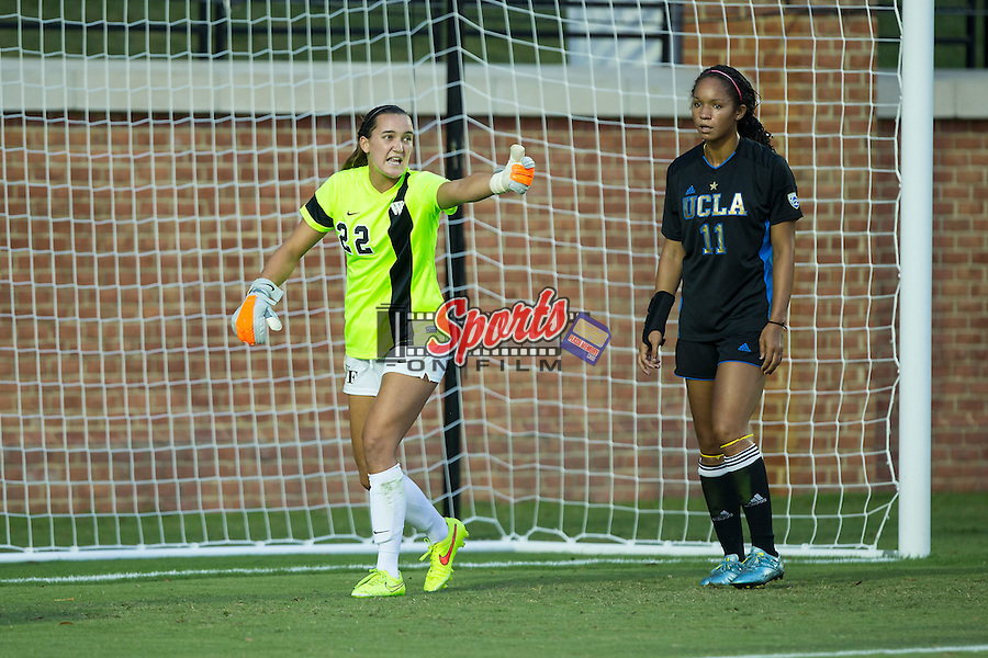 Nonie Frishette (22) of the Wake Forest Demon Deacons and Darian Jenkins (11) of the UCLA Bruins prior to a corner kick during first half action at Spry Soccer Stadium on September 11, 2015 in Winston-Salem, North Carolina.  The Bruins defeated the Demon Deacons 2-1.  (Brian Westerholt/Sports On Film)