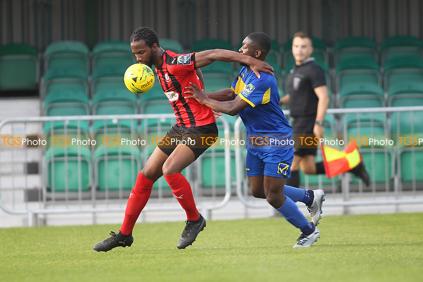 Dexter Peter of Cogeshall and Ayo OluKoga of Romford during Romford vs Coggeshall Town, Bostik League Division 1 North Football at Rookery Hill on 13th October 2018