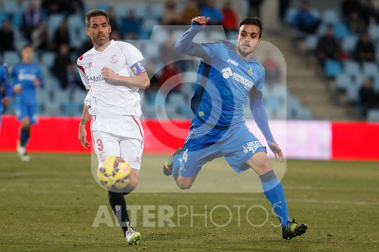 Getafe´s Pedro Leon (R) and Sevilla´s Fernando Navarro during 2014-15 La Liga match at Alfonso Perez Coliseum stadium in Getafe, Spain. February 08, 2015. (ALTERPHOTOS/Victor Blanco)