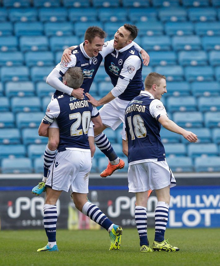 GOAL CELEBRATION - Millwall's Jed Wallace celebrates scoring his sides second goal with team mates<br /> <br /> Photographer Craig Mercer/CameraSport<br /> <br /> Football - The Football League Sky Bet League One - Millwall v Blackpool - Saturday 5th March 2016 - The Den - Millwall<br /> <br /> &copy; CameraSport - 43 Linden Ave. Countesthorpe. Leicester. England. LE8 5PG - Tel: +44 (0) 116 277 4147 - admin@camerasport.com - www.camerasport.com
