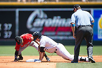 Jason Coats (17) of the Charlotte Knights slides into second base ahead of the tag by Gustavo Nunez (12) of the Indianapolis Indians at BB&T BallPark on June 21, 2015 in Charlotte, North Carolina.  The Knights defeated the Indians 13-1.  (Brian Westerholt/Four Seam Images)