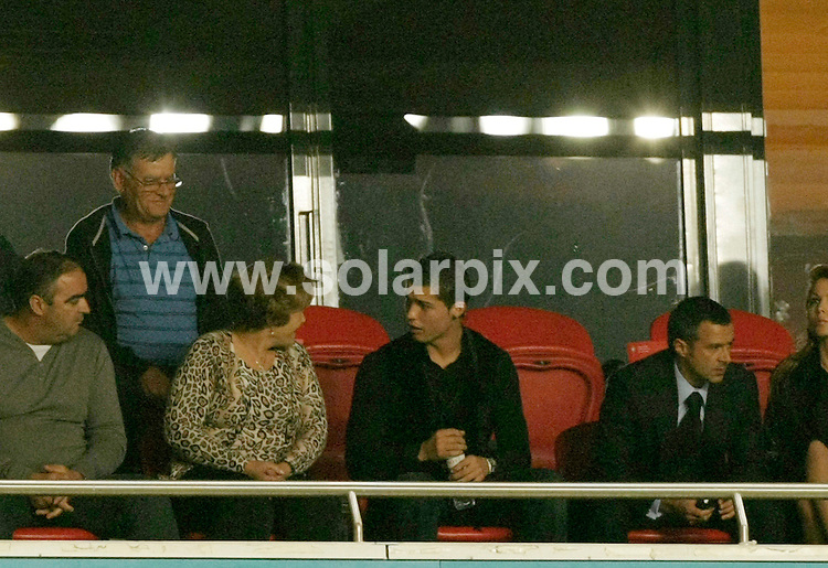 **ALL ROUND PICTURES FROM SOLARPIX.COM**.**WORLDWIDE SYNDICATION RIGHTS EXCEPT FOR PORTUGAL AND SPAIN** **NO PUBLICATION IN PORTUGAL OR SPAIN**.Cristiano Ronaldo and his mother at last nights game the game between Portugal and Bosnia.The result was 1-0 Portugal at the Estadio De Luz in Lisbon Portugal...This pic:Cristiano Ronaldo..JOB REF:10269      NPP     DATE:14.11.09.**MUST CREDIT SOLARPIX.COM OR DOUBLE FEE WILL BE CHARGED**.**MUST NOTIFY SOLARPIX OF ONLINE USAGE**.**CALL US ON: +34 952 811 768 or LOW RATE FROM UK 0844 617 7637**