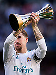 Sergio Ramos of Real Madrid holds the FIFA Club World Cup trophy prior to the La Liga 2017-18 match between Real Madrid and FC Barcelona at Santiago Bernabeu Stadium on December 23 2017 in Madrid, Spain. Photo by Diego Gonzalez / Power Sport Images