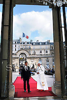 French President Nicolas Sarkozy, right, greets Pope Benedict XVI, left, upon his arrival at the Elysee Palace in Paris, Friday, Sept. 12, 2008. .