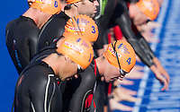 25 AUG 2013 - STOCKHOLM, SWE - Alistair Brownlee (GBR) (right, #4) of Great Britain waits for the start of the swim at the men's ITU 2013 World Triathlon Series round in Gamla Stan, Stockholm, Sweden (PHOTO COPYRIGHT © 2013 NIGEL FARROW, ALL RIGHTS RESERVED)