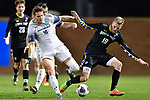 GREENSBORO, NC - DECEMBER 02: Chase Lennartz #19 of North Park University battles Sam Vinson #16 of Messiah College for the ball during the Division III Men's Soccer Championship held at UNC Greensboro Soccer Stadium on December 2, 2017 in Greensboro, North Carolina. Messiah College defeated North Park University 2-1 to win the national title. (Photo by Grant Halverson/NCAA Photos via Getty Images)