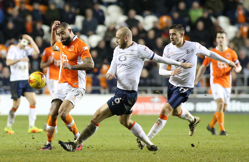 Blackpool's Kyle Vassell plays the ball away from Luton Town's Scott Cuthbert<br /> <br /> Photographer David Shipman/CameraSport<br /> <br /> The EFL Sky Bet League Two - Blackpool v Luton Town - Saturday 17th December 2016 - Bloomfield Road - Blackpool<br /> <br /> World Copyright &copy; 2016 CameraSport. All rights reserved. 43 Linden Ave. Countesthorpe. Leicester. England. LE8 5PG - Tel: +44 (0) 116 277 4147 - admin@camerasport.com - www.camerasport.com
