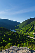 Franconia Notch from Bald Mountain in the White Mountains of New Hampshire during the spring months. Echo Lake is in the middle of the scene.