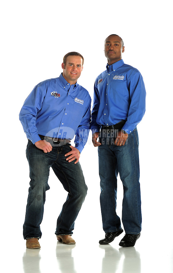 Jan. 8, 2012; Brownsburg, IN, USA; NHRA top fuel dragster driver Antron Brown (right) and funny car driver Matt Hagan pose for a portrait during a photo shoot at the Don Schumacher Racing shop. Mandatory Credit: Mark J. Rebilas-