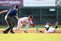 June 10th 2008:  Shortstop Iggy Suarez (17) of the Portland Seadogs, Class-AA affiliate of the Boston Red Sox, attempts to tag Kody Kirkland (8) of the Erie Seawolves as umpire Doug Levy watches during a game at Jerry Uht Park in Erie, PA.  Photo by:  Mike Janes/Four Seam Images