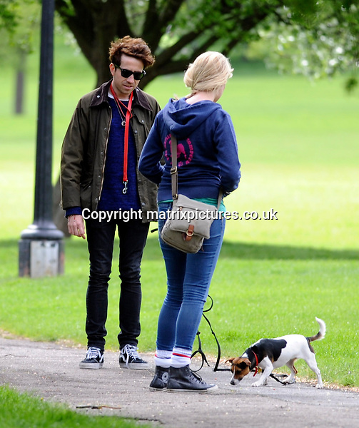 EXCLUSIVE ALL ROUND PICTURE: MATRIXPICTURES.CO.UK.PLEASE CREDIT ALL USES..WORLD RIGHTS..British radio and television presenter Nick Grimshaw is pictured out with his new Jack Russell Terrier and a professional dog trainer in North London...The popular DJ was seen getting tangled up in his pooch's 30ft lead during an afternoon training session...MAY 9th 2013..REF: SSY 133083
