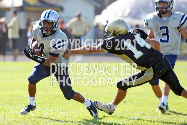 Palos Verdes, CA 09/09/11 -  unidentified North player(s) and Nick Kudrave (Peninsula #14) in action during the North Torrance-Peninsula Panthers varsity football game.