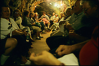 "BASIN - 2003: Sufferers of arthritis, asthma, and other chronic ailments gather in the Merry Widow Mine to inhale radon gas that seeps naturally into the gold and silver mine.  Some doctors say such ""therapy"" may be a cancer risk, but believers say the proof is in the pain relief.  (photo by Landon Nordeman)"