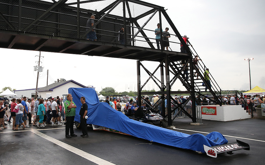 Apr. 27, 2013; Baytown, TX, USA: The car of NHRA top fuel dragster driver Brandon Bernstein sits under a rain cover during a rain delay to qualifying for the Spring Nationals at Royal Purple Raceway. Mandatory Credit: Mark J. Rebilas-