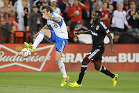 Washington D.C. - May 17, 2014: Jeb Brovsky (5) of Montreal Impact goes against Eddie Johnson (7) of D.C. United.   D.C. United tied the Montreal Impact 1-1 during a Major League Soccer match for the 2014 season at RFK Stadium.