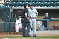 Lynchburg Hillcats manager Rouglas Odor (24) discusses a call with home plate umpire Austin Jones during the game against the Winston-Salem Dash at BB&T Ballpark on May 3, 2018 in Winston-Salem, North Carolina. The Dash defeated the Hillcats 5-3. (Brian Westerholt/Four Seam Images)