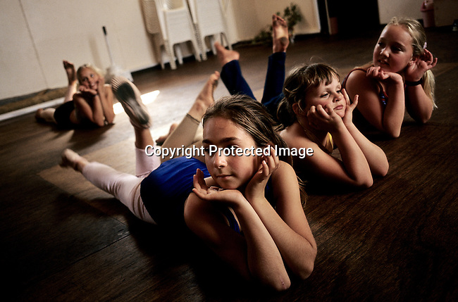 Unidentified ballet students train in a hall on September 24, 2002 in Orania, in the Northern Cape Province, South Africa. The village was founded in 1991 and bought by descendants of Hendrik Verwoerd, the architect of Apartheid. It's run as a private town only accepting whites. About 600 Afrikaners lives in the village where they celebrate their culture and keep traditions alive. They have chosen not to live in today's South Africa; a country ran by a black government since 1994. (Photo by: Per-Anders Pettersson)....