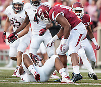 STAFF PHOTO ANTHONY REYES &bull; @NWATONYR<br /> Arkansas' Trey Flowers taunts Joel Bouagnon of Northern Illinois University after a tackle for negative yards in the first quarter Saturday, Sept. 20, 2014 at Razorback Stadium in Fayetteville.
