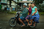 People ride a motorbike in Kalay, a town in Myanmar.