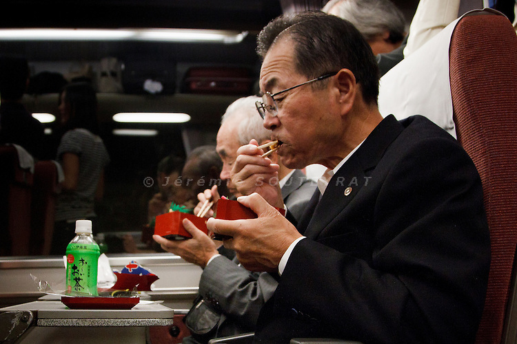 October 2011 - Eating ekiben (lunch box bought on the train stations) on the train.