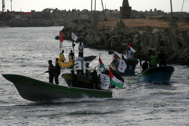 Hamas marine security take to the open waters from Gaza City port on May 28, 2010 a day before the expected arrival of a flotilla of hundreds of pro-Palestinian activists trying to break a 3-year blockade of the Gaza Strip. Two cargo ships and five smaller boats loaded with thousands of tonnes of supplies and hundreds of passengers will be delayed by a day until May 29, organisers said, before they embark on the final leg of their attempt to bust the Gaza Strip embargo, a bid Israel vowed to defeat. Photo by Ashraf Amra