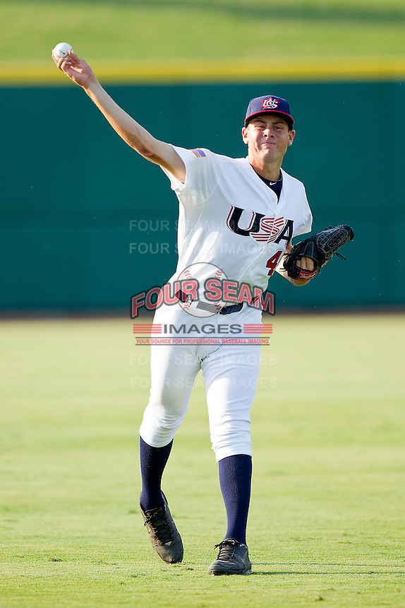 Starting pitcher Lucas Giolito #49 of the USA 18u National Team throws in the outfield prior to the game against the USA Baseball Collegiate National Team at the USA Baseball National Training Center on July 2, 2011 in Cary, North Carolina.  The College National Team defeated the 18u team 8-1.  Brian Westerholt / Four Seam Images