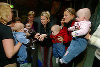 Young mothers and their children at a song and play class for babies..In contrast to most European countries, the Norwegian birth rate is a healthy 1.9. Norway's reputation as a child friendly society is partially founded on a succession of government initiatives to improve parents' rights and economic circumstances.