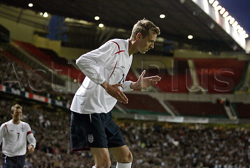 30 May 2006: England striker Peter Crouch does his robot celebration after he scores the third goal during the International Friendly match between England and Hungary played at Old Trafford. England won the game 3-1 Photo: Neil Tingle/Actionplus...060530 football soccer player joy celebrate