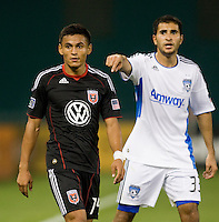 Andy Najar (14) of D.C. United is covered on defense by Steven Beitashour (33) of the San Jose Earthquakes celebrates his first goal during the game at RFK Stadium in Washington, DC.  D.C. United was defeated by the San Jose Earthquakes, 4-2.