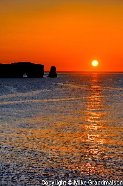 Rocher percé (Percé Rock)  at sunrise and the Atlantic Ocean<br /> Percé <br /> Quebec<br /> Canada