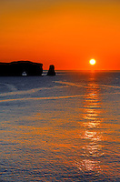 Rocher perc&eacute; (Perc&eacute; Rock)  at sunrise and the Atlantic Ocean<br /> Perc&eacute; <br /> Quebec<br /> Canada