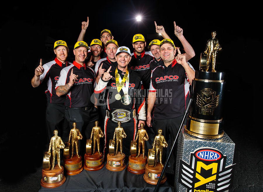 Nov 11, 2018; Pomona, CA, USA; NHRA top fuel driver Steve Torrence (center) poses for a portrait with his crew after winning the Auto Club Finals at Auto Club Raceway. Torrence swept all six of the countdown to the championship races to clinch the world championship. Mandatory Credit: Mark J. Rebilas-USA TODAY Sports