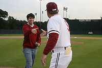 STANFORD, CA - FEBRUARY 20:  National Anthem singer (left) and head coach Mark Marquess #9 (right) during Stanford's season opener game against the Vanderbilt Commodores on February 20, 2009 at Sunken Diamond in Stanford, California.