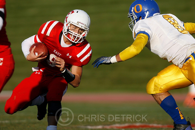 Chris Detrick  |  The Salt Lake Tribune.East's Jason Cook (8) runs past Orem's Kaleb Egbert (8) during the game at East High School Friday October 28, 2011.  East won the game 31-13.